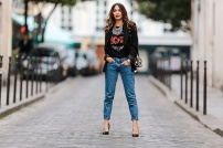 PARIS, FRANCE - NOVEMBER 27: Sofya Benzakour (fashion and life style blogger - La couleur du moment), is wearing a Zara t-shirt with the AC-DC rock band logo, Reiko blue denim jeans, Zara black heels shoes, a Tobi black jacket, a Forever 21 necklace, and a Morgan black and white bag, on November 27, 2016 in Paris, France. (Photo by Edward Berthelot/Getty Images)